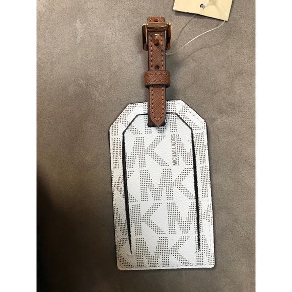 703fbc77f7d0 Michael Kors vanilla logo MK luggage tag